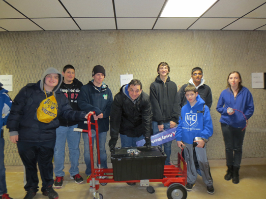 Members of the Bethpage High School robotics team are pictured displaying the contents of the kit of parts.