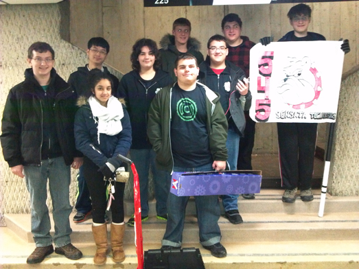 Members of the Island Trees High School robotics team display the contents of the kit of parts.