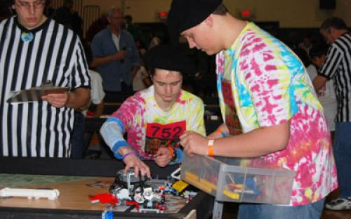 "Members of the Bayport ""Peaced Together"" — Team #752 prepare to program their robot for the course at the March 6 Long Island LEGO League Tournament, ""Body Forward."" Five hundred students from 48 teams participated in the event."